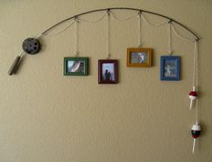 Decorating-Ideas6 on The Owner-Builder Network. Fishing pole picture hanger.  http://theownerbuildernetwork.com.au/wp-content/blogs.dir/1/files/decorating-ideas-1/Decorating-Ideas6.jpg