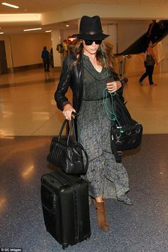 Solo yet stylish: Nikki Reed donned an impeccably trendy looked as she jetted into Los Angeles on Monday - the actress did not appear to be accompanied by her boyfriend Ian Somerhalder, whom she was seen with at LAX on Friday