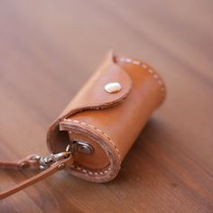 Why settle for cheap & crappy when you can have beautiful leather? Leather Dog Poop Bag Dispenser by HanaAzuki on Etsy, $25.00