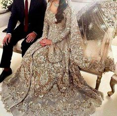 Beutifull bridal maxi in skin golden color work embellished with dull silver naqshee dabka nagh zari kora pearls crystals and heavy cut work in arm and maxi border.