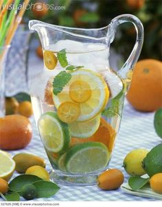 Jug of water with citrus fruit, lemon balm and ice cubes [327626] > Stock Photos | Royalty Free | Royalty Free Photos > Visualphotos.com