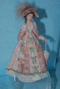 """Terri Davis - Edwardian woman wearing a dusty rose colored silk taffeta jacket over a  silk print skirt. This wonderful custom print silk is from""""Magic Miniatures"""". Her outfit is trimmed with delicate vintage cotton lace and green silk ribbon. Under her dress she wears lace trimmed cotton organdy pantalets and petticoat, lace stockings, and silk high button boots. The mold used to make the figurel was made by Stacey Hoffman. sold on ebay for $238.49"""