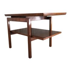 """Vintage Asymmetrical side table by Jens Risom Design. The architectural design of this table gives it the appearance of a floating top. This table is in excellent vintage condition without major dings or scratches.   Dimensions: 30""""L x 21""""W x 22""""H"""