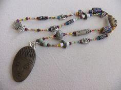 Carved Faces and African Trade Bead Tribal by centerofbalance, $50.00