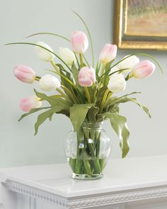 A pleasing combination of exuberance and gentility, these pink & white silk tulips make delightful accents. In pink and white or red and yellow, the lifelike petals rest amid sprigs of grass in our hiqh quality glass vase.