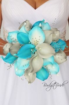 flowers Turquoise and grey theme wedding flower brides bouquet with grey calla lilies, t. Turquoise and grey theme wedding flower brides bouquet with grey calla lilies, turquoise and turquoise tipped calla lilies accented with silver pearls Turquoise Wedding Bouquets, Turquoise Bouquet, Lily Bouquet Wedding, Beach Wedding Bouquets, Wedding Flower Guide, Calla Lily Bouquet, Wedding Flower Arrangements, Bride Bouquets, Calla Lilies