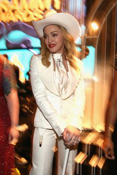 Finally, Madonna standing in all her glory with her walking stick and cowboy hat. At the Grammys 2014