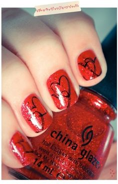 Paint nails red. Then use a sharpie to draw hearts. If you mess up the sharpie comes off with rubbing alcohol