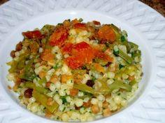 Sardinian fregola with bottarga and artichokes. Sardinian recipes - sardische Rezepte Sardische Fregola mit Bottarga und Artischocken.