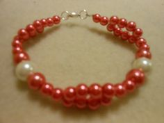 Bracelet beaded with bright or dark pink small by JewelrybyKN