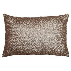 """Add a luxe touch to your daybed or chaise with this eye-catching lumbar pillow, featuring a metallic sequin cover.  Product: PillowConstruction Material: Polyester coverColor: HumusFeatures: Insert includedDimensions: 12"""" x 18""""Cleaning and Care: Spot clean"""