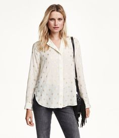 Blouse in chiffon with concealed buttons at front, yoke at back with box pleat, and long sleeves with button at cuffs.