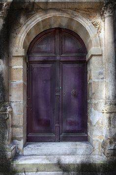 This is a doorway in the Latin Quarter, Paris France, from the archway to the wood, everything about the door depicted ancient of days.