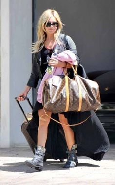 Ashley Tisdale wearing Louis Vuitton Monogram Vernice Key and Change Holder, Louis Vuitton Monogram Canvas Keepall 55 with Shoulder Strap, Louis Vuitton Monogram Canvas Pegase Suitcase, Doma Cropped Moto Jacket, Chanel Veau Ver Large Quilted Tote, Gucci Mirror Sunglasses and Jeffrey Campbell Studded Ryder Boots.