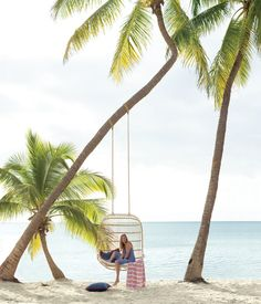 Relaxing in a double hanging rattan chair on the beach. http://www.serenaandlily.com/  © Laurie Frankel Photography