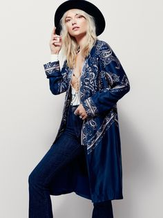 Bandana Printed Kimono | In a silky fabrication and bandana print this long and effortless kimono features long sleeves and an open front. Lined.