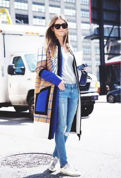 A printed coat elevates a simple T-shirt, jeans and sneakers.