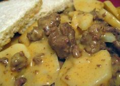 Ingredients 5 large russet potatoes, peeled and sliced about 1/4-1/2 inch thick 2 -3 tablespoons chopped onions 1 lb ground beef ( really lean is preferable) salt and pepper Cheese sauce (the same one I use for macaroni and cheese) 2
