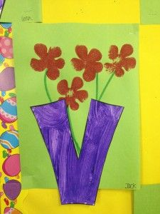 V is for vase.  Paint a large v shape.  Glue onto green paper and draw stems and stamp flowers.