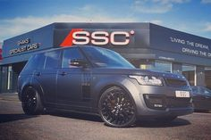 "In stock now Kahn Design's Range Rover Vogue Geneva 2015 show vehicle in Satin Black colour change 23"" Gloss Black wheels full red interior conversion full service and remaining dealer warranty cover.  Now in stock for 109995.00  For more details contact myself at: patel@s-s-c.co.uk 01484 480 777  Please follow @sscbespoke  #landrover #land_rover #rangerover #range_rover #projectkahn #kahndesign #rangerover #rangeroversport  #svr #rangeroversportsvr #autobiography #fitness #4x4 #landrover…"