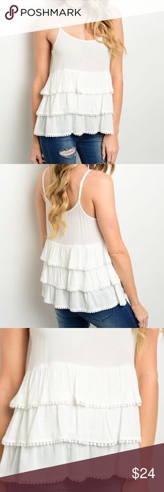 """Ivory Ruffle Tank Top Spaghetti strap Ivory top features a round neckline and multi-tiered detail. 100% Rayon . perfect to pair with jeans, leggings, pants or skirts.  Measurements for small: Length: 25"""" Bust: 38"""" Waist: 36"""". Tops Tank Tops"""