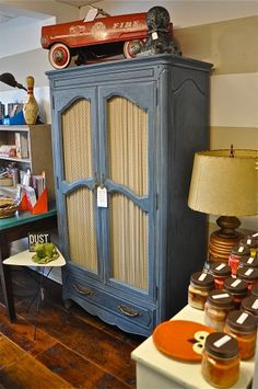 Hand painted furniture items and vintage finds adorn the walls at Bungalow 47
