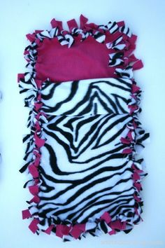 Fleece Sleeping Bag And Blanket, although perhaps in colors other than zebra and pink.