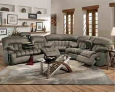 This gorgeous, comfortable, sectional sofa features a reclining sofa with a drop-down table, a reclining loveseat with a console and a large corner wedge. Brown, padded suede microfiber upholstery provides comfort and style Reclining Sofa, Contemporary Sofa, Sofa Decor, Leather Corner Sofa, Furniture, Home, Sectional Sofa With Recliner, Sofa Inspiration, Cozy Place