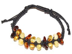 <span style='font-family: Arial; font-size: 16px;'>The Baltic Amber Sand and Surf bracelet is reminiscent of a day at the beach! These Amber bracelets are fun, relaxing, and eye-catching. The Amber Sand and Surf Bracelet is adjustable (just pull the strings to make it tighter, or loosen them if you need it larger!<br /> <br /> The stones and rope/string colors vary on each of these beautiful bracelets. Colors of the Amber stone/beads will vary.<br /> <br /> Beautifully handcrafted, each Sand…
