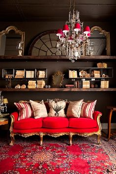 Love the vintage sofa, pillow mix....and the shelves on black wall for books, stuff and mirrors....great look