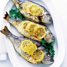 Bring out sea bream's lovely mild flavour - try our baked bream with lemon and parsley recipe