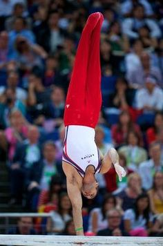 Danell Leyva competes on the parallel bars during the men's Olympic gymnastics team final in London for Team USA.