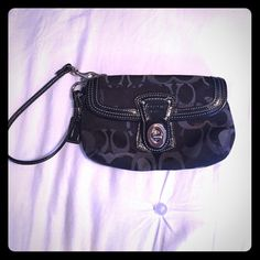Black Coach Logo Wristlet Black Coach Wristlet with Coach logo pattern. Zipper pocket with clasped front pocket. Strap for carrying on your wrist. No visible signs of wear, great condition. $20 OBO. Coach Bags Clutches & Wristlets