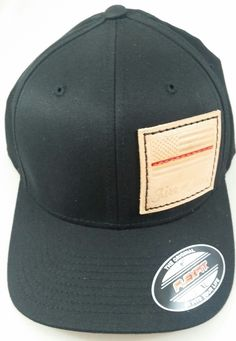9c3077b7e26 This Flexfit hat has features the Thin Red Line stamped on a raw leather  patch.