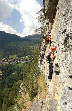 Rock climber on the Via Ferrata, Champéry, Valais