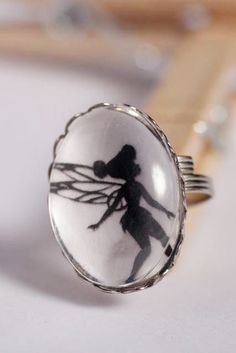 Tink Silohetter Ring -- I could do this with a pic behind glass glob
