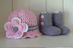 My niece makes this adorable beanie and booties set. Check out her page for many other great things!  http://www.etsy.com/listing/82758845/baby-gift-set-ankle-booties-and-scallop
