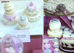 http://www.lemienozze.it/gallerie/torte-nuziali-foto/img28067.html  Mini torte nuziali e confetti per il matrimonio