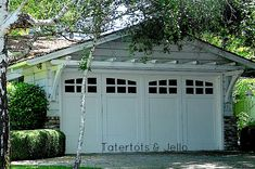 DIY Arbors and Trellis | pergola above a garage adds architectural interest to a plain facade ...