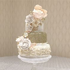 It was nice to design again after a 3 month interlude while enjoying my new baby girl at home. This beauty was delivered to The DoubleTree by Hilton. Congratulations to the beautiful couple, Deanna & Jim! xo #weddingcake #yqr #sugarweddingcakes #sugarflowers #cake