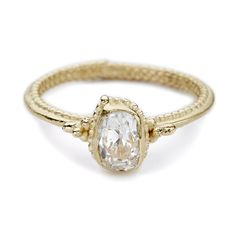 Unique antique cut white diamond solitaire engagement ring in yellow gold. Handmade in Ruth Tomlinson's London studio, perfect for a bride with vintage style.