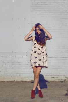 Adorable cat dress.