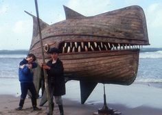 "Whale of Canoe: ""Wooden Whaler"" is a whale sculpture made out of two derelict wooden fishing boats by British artist David Kemp. Wooden Canoe, Wooden Boats, Wooden Fish, Sand Pits For Kids, Street Art, Boat Shed, Photo Images, Old Boats, Boat Painting"