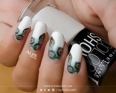 Peacock nails / Feather nails with Real peacock feathers by @alpsnailart