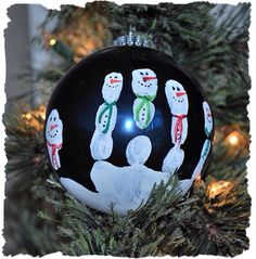 Child's Handprint on a Bulb. Then make each Finger Print Into a Snowman. Easy, Fast, & Great Milestone Keepsake!