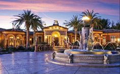 Gorgeous fountains, lighting, palms and architecture.