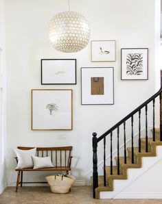 Creating the right staircase gallery wall layout can be tricky. A balanced staircase gallery wall layout is key to achieving a timeless arrangement. Staircase Wall Decor, Stair Walls, Wall Art Decor, Stair Photo Walls, Stairway Wall Art, Staircase In Living Room, Decorating Staircase, Staircase Frames, Stairway Photos