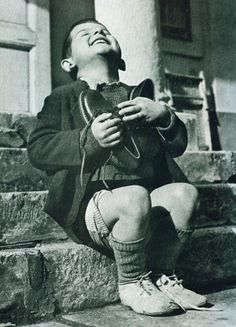 """Austrian boy receiving new shoes after WWII. """"New Shoes"""" by Gerald Waller, Austria Six year-old Werfel, living in an orphanage in Austria, hugs a new pair of shoes given to him by the American Red Cross. This photo was published by Life magazine. Vintage Photography, White Photography, Photography Kids, Old Pictures, Old Photos, Rare Photos, Iconic Photos, Bizarre Photos, Famous Pictures"""