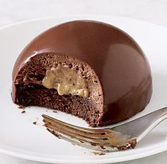 German Chocolate Bombes. These showstoppers are a creative spin on a classic dessert. Here, individual ganache-glazed chocolate cake bombes are filled with decadent chocolate mousse and creamy pecan-coconut pudding. And, they're the perfect ending for a dinner party because you can make them ahead! YUM!!!