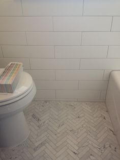 Bianco Venatino Herringbone Bathroom Project | Architectural Ceramics: This bathroom features our stock bianco venatino herringbone on floor with our 4x16 arctic tile on walls. Silver shadow grout used on both.